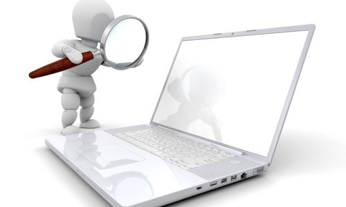 White-Character-Magnifying-Glass-on-Laptop.jpg